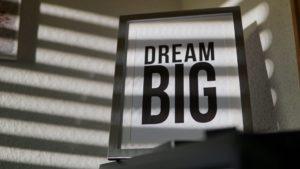 "a photo in a frame that reads ""DREAM BIG"""